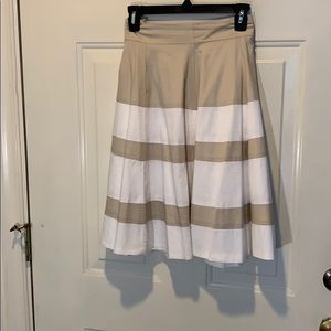 Beautiful A-line beige/white color blocked skirt.